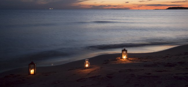 lights by the sea shore. flying with kids relaxed best tips